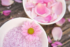 Time for relaxing. Aromatherapy salts & flowers - shallow depth of field Royalty Free Stock Photo