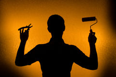Time for repair and Renovation. Silhouette of man Stock Images