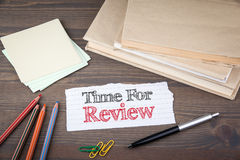 Time for review. Paper sheet from the booklet on the wooden table Royalty Free Stock Photos