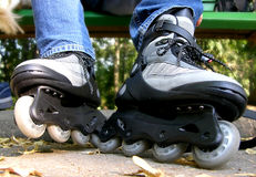 Time for Rollerblades. Putting on Rollerblades in the park Royalty Free Stock Photos