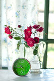 Time and roses Stock Images