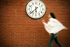 Time is running. A young woman running, trying to beat the time Royalty Free Stock Photography