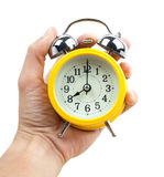 Time is running  classic alarm clock in a hand. Isolated Royalty Free Stock Photos