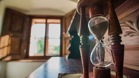 Time is running in the hourglass stock footage