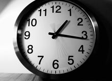Time is running out!. A capture of a clock with slow shutterspeed, showing the second-arm moving royalty free stock image