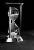 Time running out. Hour glass with sand running out Royalty Free Stock Images