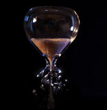 Time running out. An hour glass with a broken bottom Royalty Free Stock Photography
