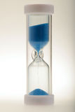 Time is running out. Hourglass in operation to represent that a time period has begun already Royalty Free Stock Photography