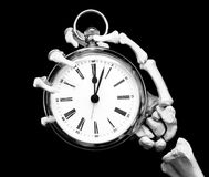 Time's up. Skeleton holds a fob style clock Royalty Free Stock Image
