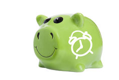 Time saving concept. Piggy bank with alarm clock symbol Stock Image
