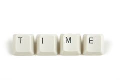Time from scattered keyboard keys on white Royalty Free Stock Images
