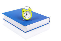 Time for school. Alarm clock on the book as time to school concept Stock Photo