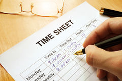 Time sheet. Records work hours in a time sheet Stock Images