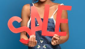 Time for shopping! Girl with sale letters. stock photography