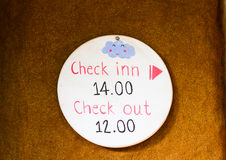 Time sign at resort Royalty Free Stock Photography
