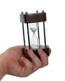 Time slipping away. Hand holding hour glass royalty free stock photo