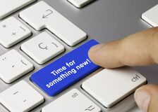 Time for something new! - Inscription on Blue Keyboard Key