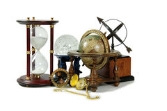 Time, space, and the universe. Hour glass, Crystal ball, Antique time zone converter used by travellers, Gold pocket watch, Old world globe with basic navigation Stock Photos
