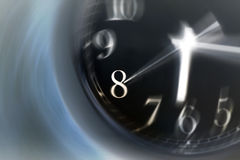 Time Spinning Fast. Time spins by fast on the face of a clock (motion blur, inverted effect royalty free stock image