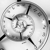 Time Spiral. An infinite time spiralling clock Stock Image