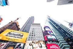 Times Square, NYC / USA - December 22 2016: Various Skyscrapers and billboards on display in the busy Time Square NYC royalty free stock images