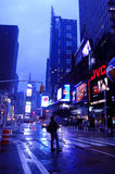 Time Square after storm. A man waits at street, Time Square, Manhattan, New York Stock Photo