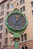 Time Stops. Sidewalk street side clock Royalty Free Stock Images