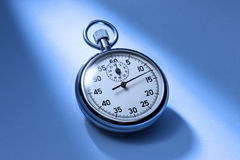 Time Stopwatch. A stopwatch with a shaft of light and a blue tone Stock Photos