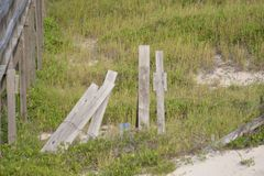 Time and stormy weather can take their toll of the wooden boardwalks that rise over the sand dunes stock photo