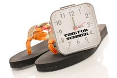 Time For Summer. Clock with Sandals stock image
