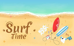 Time for surfing. On the beach are things, a surfboard and accessories. Summer weekend. Top view of the beach. Exotic zone of rest Royalty Free Stock Images