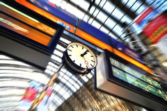 Time table and clock in train station. Panel indicator for Amsterdam train in Frankfurt train station. Time clock indicator near royalty free stock image