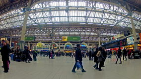 Time table view timelapse of Commuters inside Victoria Railway Station in London. LONDON, UNITED KINGDOM - DECEMBER 1, 2013: 4K Quad Ultra Time table view stock video footage