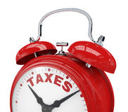 Time for taxes. Close up view of a vintage alarm clock with the text: taxes instead of the numbers (3d render Royalty Free Stock Image