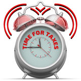 Time for taxes. The alarm clock with an inscription Stock Images