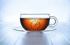 Time Tea Cup Clock. A clock tea cup on a light background. This image is available without the clock. Image No 53071125 Royalty Free Stock Photos