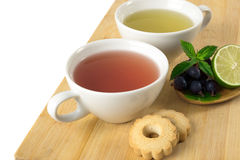 Time for tea. Cups of tea on wooden board Stock Photos