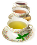 Time for tea. Three cup of tea in row  on white background Stock Images