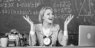 It is time. teacher with alarm clock at blackboard. Time. Back to school. Teachers day. Study and education. Modern stock photo