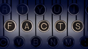Time-tested Facts. Image of old typewriter keyboard with scratched chrome keys that spell out the word FACTS. Lighting and focus are centered on FACTS Stock Images