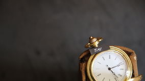 Time text and old pocket watch stock footage