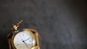Time text and old pocket watch stock video