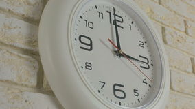 Time three hour. Timelapse. Round white clock hanging on brick wall. Time three hour. Timelapse. Round white clock hanging on a brick wall stock video