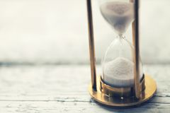 Time is ticking - hourglass on the table with copy space Stock Images