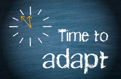 Time to adapt with clock and text Royalty Free Stock Photos