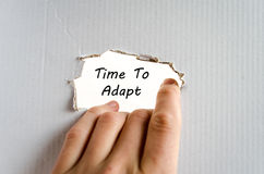 Time to adapt text concept. Isolated over white background Royalty Free Stock Photo