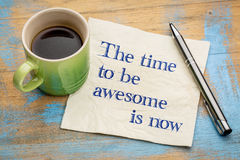 The time to be awesome is now. Handwriting on a napkin with a cup of espresso coffee Royalty Free Stock Photos
