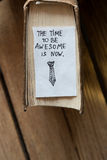The time to be awesome is now. Idea, book and the inscription Stock Images