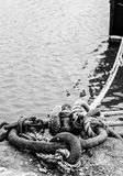 Time To Break Free?. Boat mooring in small Scottish fishing harbour Royalty Free Stock Photography