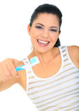 Time To Brush Teeth. Attractive young woman giving tooth brush. isolated on white stock photography
